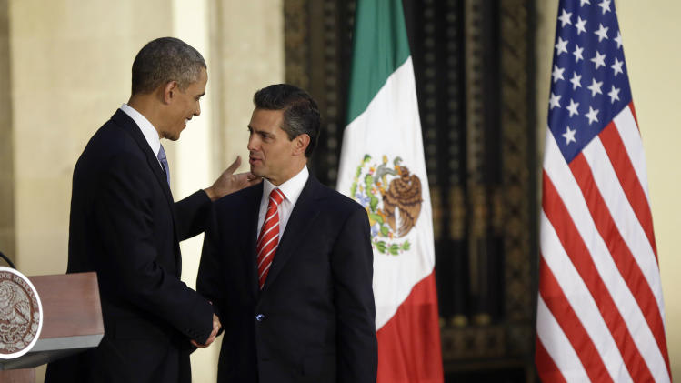 President Barack Obama and Mexico's President Enrique Pena Nieto shake hands at a news conference at the Palacio Nacional in Mexico City, Thursday, May 2, 2013. (AP Photo/Pablo Martinez Monsivais)