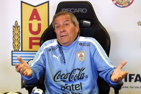 Uruguay's national soccer team head coach Tabarez gestures during a news conference at the team's headquarters in the outskirts of Montevideo