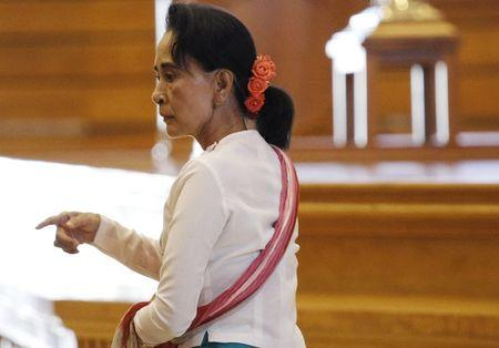 NLD leader Aung San Suu Kyi arrives at a parliament meeting room after meeting with Shwe Mann, speaker of Myanmar's Union Parliament, at the Lower House of Parliament in Naypyitaw