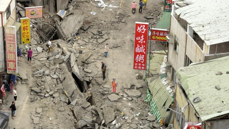 A view from a rooftop shows the road after an explosion occurred in Kaohsiung
