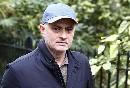 Former Chelsea soccer club manager Jose Mourinho walks near to his home in London