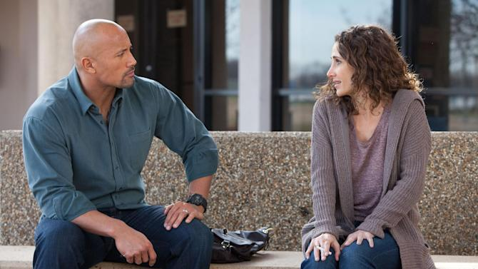 "This film image released by Summit Entertainment shows Dwayne Johnson, left, and Melina Kanakaredes in a scene from ""Snitch."" (AP Photo/Summit Entertainment, Steve Dietl)"