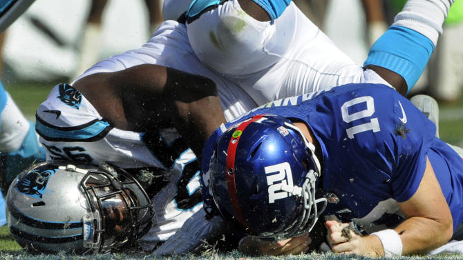 Newton, defense lead Panthers past Giants 38-0