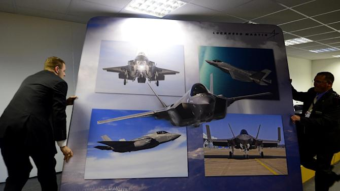 A backdrop is installed ahead of a press briefing on the Lockheed Martin BST F-35 at the Farnborough air show in Farnborough, Hampshire on July 14, 2014
