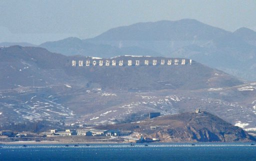 <p>This file photo shows a border area of North Korea's west coast, dotted with artillery bunkers and a sign reading 'Long live Great leader Kim Il-Sung and his revolutionary ideology!', as seen from South Korea's Yeonpyeong Island in the disputed waters of the Yellow Sea, in 2010.</p>