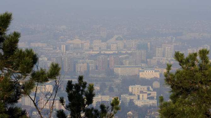 In this picture taken on Sunday, Dec. 15, 2013, buildings can be seen through the polluted air over Macedonia's capital Skopje, from Vodno Mountain just above the city. Six days of high levels of harmful air pollution has forced Macedonian government on Tuesday to order companies and state institutions in four regions, including capital Skopje, to exempt from work pregnant woman and people over 60 years of age. (AP Photo/Boris Grdanoski)