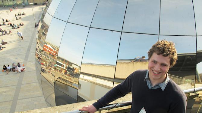The Cambridge University student who is named UK Cyber Security Champion Jonathan Millican, poses for a photograph with his trophy at the Science Museum in Bristol, England, Sunday, March 11, 2012.  Millican is named UK Cyber Security Champion after beating off other contestants in the Cyber Security Challenge to seek out viruses and malware, raise firewalls and fend off hack attacks, in a competition aimed at pulling new talent into Britain's burgeoning cybersecurity sector.  (AP Photo/Raphael Satter)