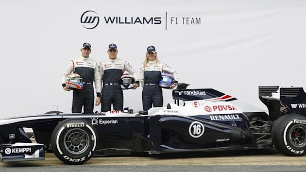 Williams Formula One drivers Pastor Maldonado (L) and Valtteri Bottas and test-driver Susie Wolff (R) pose with the new FW35 racing car during its presentation at Circuit de Catalunya racetrack in Montmelo, near Barcelona, February 19, 2013 (Reuters)