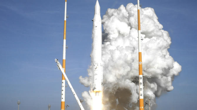 In this photo released by Korea Aerospace Research Institute, South Korea's rocket lifts off from its launch pad at the Naro Space Center in Goheung, South Korea, Wednesday, Jan. 30, 2013. South Korea says it has successfully launched a satellite into orbit from its own soil for the first time. Wednesday's high-stakes launch comes just weeks after archrival North Korea successfully launched its own satellite to the surprise of the world. (AP Photo/Korea Aerospace Research Institute)