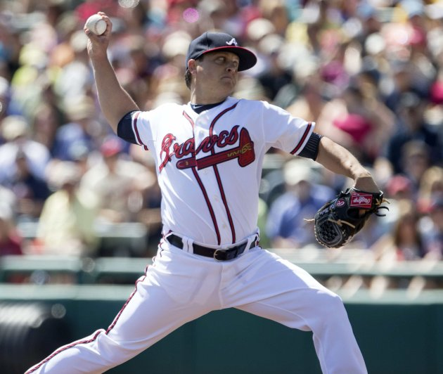 Atlanta Braves pitcher Kris Medlen works from the mound against the Toronto Blue Jays during the first inning of their MLB Spring training baseball game in Lake Buena Vista, Florida