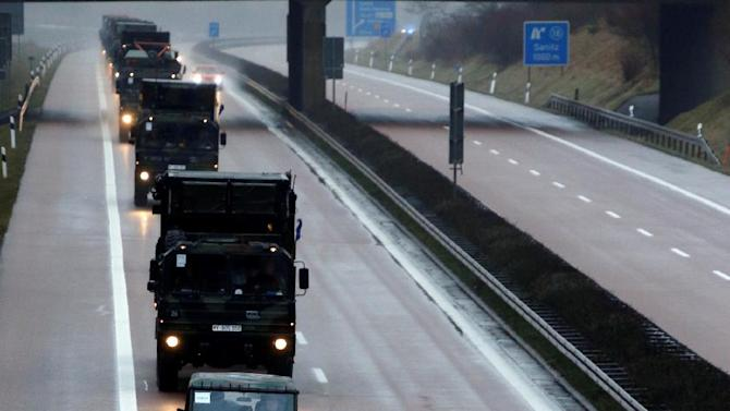 Army trucks  drive on highway A20 near Vietow , eastern Germany  on their way to Luebeck-Travemuende harbour, Sunday Jan. 6, 2013. Patriot missile batteries were being prepared for shipment from Germany to Turkey on Sunday as part of efforts meant to protect the NATO (North Atlantic Treaty Organisation) ally from potential Syrian warheads. The US, Germany and the Netherlands are each deploying two batteries of the US-built defence system to boost Turkey's air defences against any spillover from Syria's nearly two-year civil war (AP Photo/dapd/Jens Koehler)