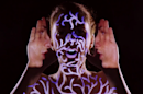This artist sang with ghostly projections of herself for her latest music video