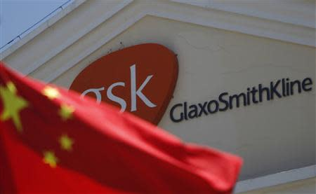 File picture shows a Chinese national flag in front of a GlaxoSmithKline office building in Shanghai