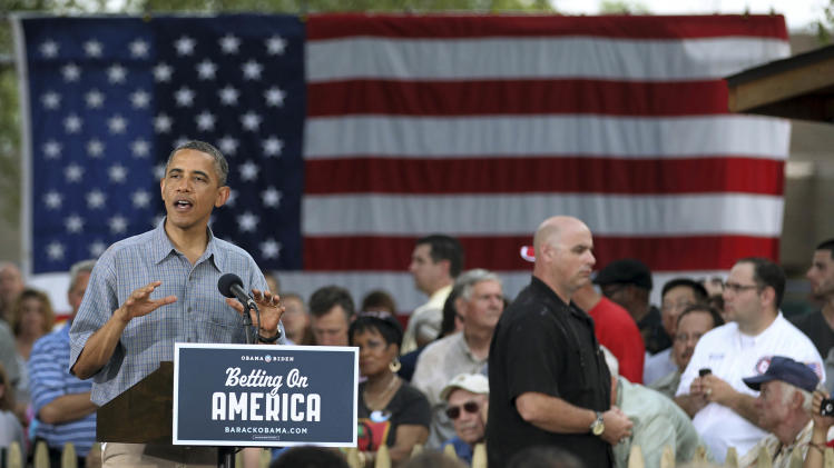 "President Barack Obama speaks at James Day Park Thursday, July 5, 2012, in Parma, Ohio. Obama is traveling through Ohio and Pennsylvania on a two-day ""Betting on America"" bus tour to highlight commitment to invest in American workers and creating jobs.  (AP Photo/Tony Dejak)"