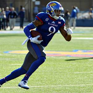 Play Of The Day: Kansas' Nigel King's Incredible Touchdown Catch.