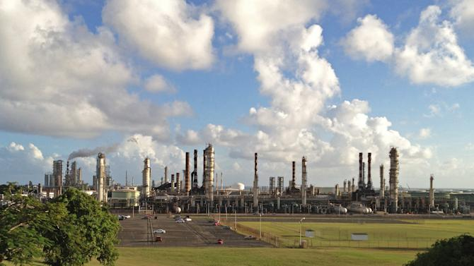 This picture taken on Oct. 29, 2011 shows the Hovensa oil refinery in St. Croix, U.S. Virgin Islands. The refinery, the largest private employer in the U.S. Virgin Islands and once one of the largest refiners in the Western Hemisphere, will cease operations next month and will be converted to an oil storage terminal, said Brian K. Lever, president and chief operating officer of Hovensa LLC.  Losses at Hovensa, a joint venture of U.S.-based Hess Corp. and Venezuela's state-owned oil company, have totaled $1.3 billion over the past three years. (AP Photo/Jason Bronis)