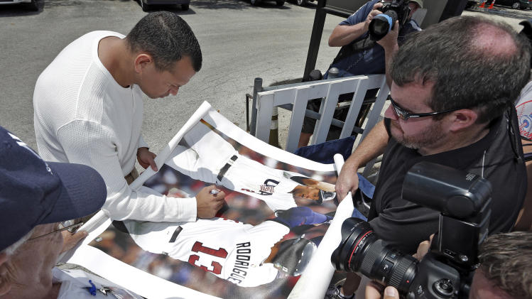 New York Yankees third baseman Alex Rodriguez, upper left, signs autographs for fans after reporting to the Yankees' Minor League complex for rehabilitation Monday, May 6, 2013, in Tampa, Fla. Rodriguez is rehabbing from hip surgery. (AP Photo/Chris O'Meara)