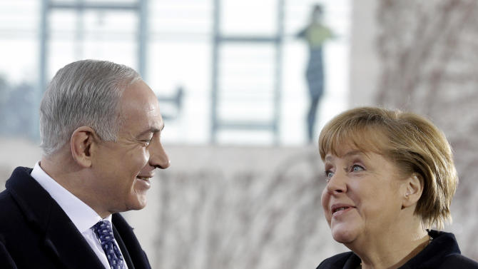 CORRECTS SPELLING OF NETANYAHU  German Chancellor Angela Merkel, right, welcomes the Prime Minister of Israel, Benjamin Netanyahu, in front of the chancellery in Berlin, Germany, Thursday, Dec. 6, 2012. It was supposed to be an amicable meeting between close friends. Instead, Israeli Prime Minister Benjamin Netanyahu's visit to Germany has been soured by Berlin's refusal to oppose a Palestinian U.N. statehood bid and anger throughout Europe over Israeli plans to expand settlements around Jerusalem. (AP Photo/Michael Sohn)