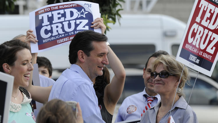 Former Texas Solicitor General Ted Cruz, center, greets supporters at a voting precinct Tuesday, July 31, 2012, in Houston. Cruz faces Lt. Gov. David Dewhurst in the Republican primary runoff election for the Republican nomination for the U.S. Senate. (AP Photo/Pat Sullivan)