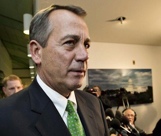 FILE - This Jan. 1, 2013 file photo shows House Speaker John Boehner of Ohio walkig past reporters after a closed-door meeting meeting of House Republicans on Capitol Hill in Washington. The GOP-controlled House will vote next week to permit the government to borrow more money to meet its obligations, a move aimed at heading off a market-rattling confrontation with President Barack Obama over the so-called debt limit. Full details aren't settled yet, but the measure would give the government about three more months of borrowing authority beyond a deadline expected to hit as early as mid-February, a Republican official said Friday. (AP Photo/J. Scott Applewhite, File)