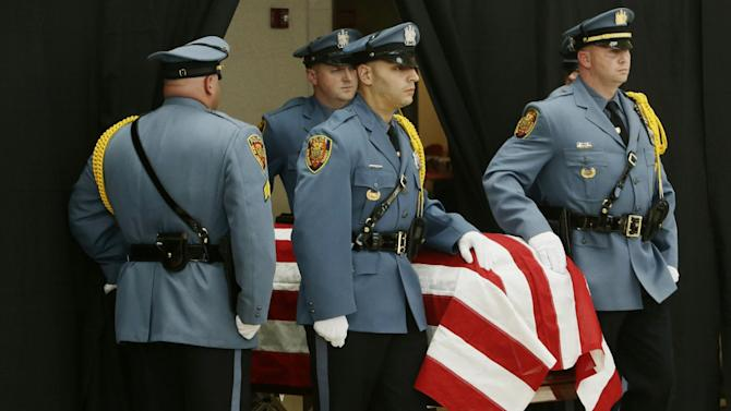 The casket of U.S. Sen. Frank Lautenberg is escorted by the New Jersey Transit Police Color Guard at the Frank R. Lautenberg Rail Station Wednesday, June 5, 2013, in Secaucus, N.J. Lautenberg, a Democrat from New Jersey, died Monday at age 89 of complications from viral pneumonia. He was remembered at his funeral at a New York City synagogue Wednesday as a tenacious champion of several causes including the environment and mass transit. Congress voted in 2000 to rename the station the Frank R. Lautenberg Secaucus Junction Station. (AP Photo/Frank Franklin II)