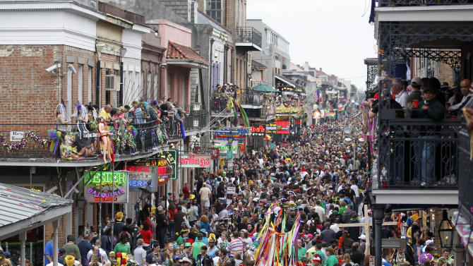 Crowds throng Bourbon Street in the French Quarter on Mardi Gras day in New Orleans, Tuesday, March 8, 2011. (AP Photo/Gerald Herbert)