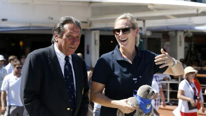 Zara Phillips walks with Commodore Cameron of Sydney's Cruising Yacht Club before the start of the Sydney to Hobart Yacht Race