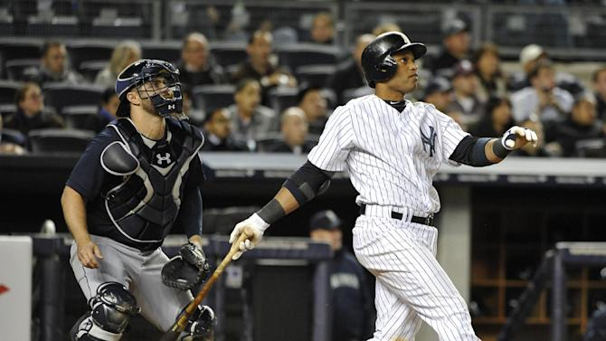 New York Yankees' Robinson Cano and Seattle Mariners catcher Kelly Shoppach watch Cano's two-run double off Seattle Mariners relief pitcher Charlie Furbush in the seventh inning of a baseball game at Yankee Stadium on Tuesday, May 14, 2013, in New York. (AP Photo/Kathy Kmonicek)