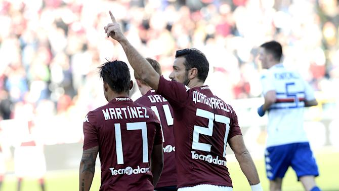 Torino's Fabio Quagliarella, right, celebrates with his teammate Josef Martinez, left, after scoring during a Serie A soccer match between Torino and Sampdoria at the Olympic stadium, in Turin, Italy, Sunday, Feb. 1, 2015. (AP Photo/ Massimo Pinca)