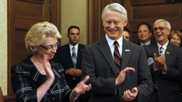 Gov. Chris Gregoire, left, and Secretary of State Sam Reed applaud after making opening remarks before signing into law Referendum 74, a citizen-passed measure that legalizes same-sex marriage in the state, Wednesday, Dec. 5, 2012, in Olympia, Wash. Gregoire and Reed both signed the document at the ceremony, which allows gay couples to marry beginning Dec. 9. (AP Photo/Elaine Thompson)