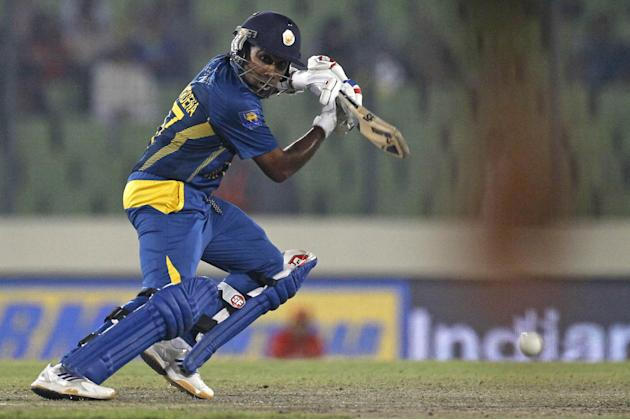 Sri Lankan cricket player Mahela Jayawardene bats during the Asia Cup final cricket match between Sri Lanka and Pakistan in Dhaka, Bangladesh, Saturday, March 8, 2014. (AP Photo/A.M. Ahad)
