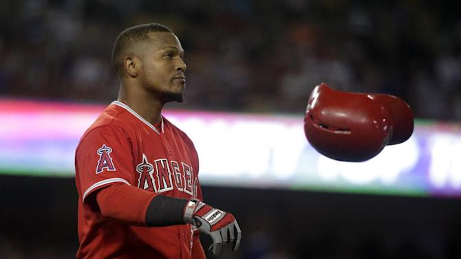 Los Angeles Angels' Erick Aybar tosses his helmet after lining out against the Los Angeles Dodgers during the fourth inning of a baseball game, Friday, July 31, 2015, in Los Angeles. (AP Photo/Jae C. Hong)