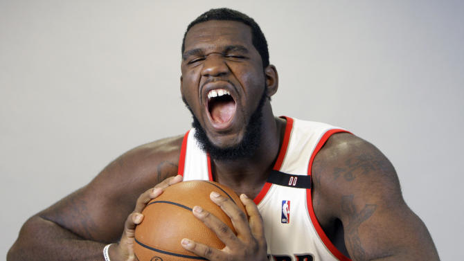 File - In this Sept. 29, 2008, file photo, Portland Trail Blazers center Greg Oden reacts while posing for a photograph during NBA basketball media day, in Portland, Ore. The Trail Blazers have been shaken by the demise of the trio many had once hoped would take the team to an NBA championship. (AP Photo/Rick Bowmer, File)