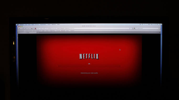 "FILE - In this Nov. 22, 2010 photo, a movie selected from among Netflix's ""Watch Instantly"" titles begins to download on a home computer screen in New York. Netflix Inc., reports quarterly financial results Monday, July, 25, 2011, after the market close.(AP Photo/James H. Collins, file)"
