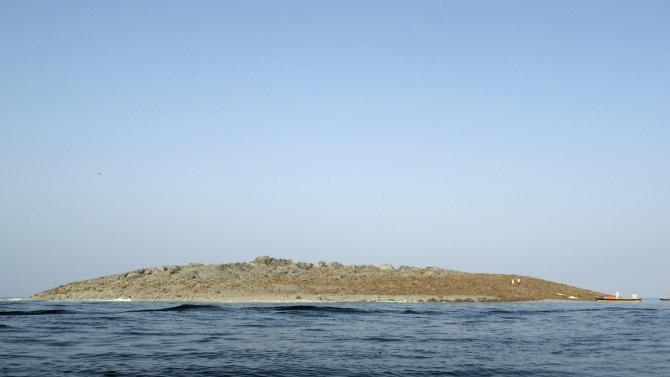 An island that rose from the sea following an earthquake is pictured off Pakistan's Gwadar coastline in the Arabian Sea