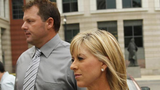 "FILE - In this July 6, 2011 file photo, former Major League Baseball pitcher Roger Clemens, and his wife Debbie Clemens arrive at federal court in Washington. As he recounted, year by year, a complicated relationship involving Roger Clemens and performance-enhancing drugs, Brian McNamee also weaved in a tale of two wives. It was McNamee's wife's nagging that prompted him to save the physical evidence that has become crucial to the government's case against the storied pitcher, and it was a request from Clemens' wife that lead to what McNamee called a ""creepy"" bathroom injection scene in Clemens' house.  (AP Photo/Alex Brandon, File)"