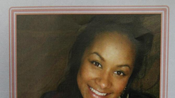 A funeral service pamphlet provided, Thursday Dec. 6, 2012, by the family of Kasandra Perkins shows a picture of Perkins holding her daughter Zoey on the front cover. Perkins was shot and killed last Saturday by her boyfriend Jovan Belcher, a Kansas City Chiefs football player. (AP Photo/Courtesy Perkins Family)