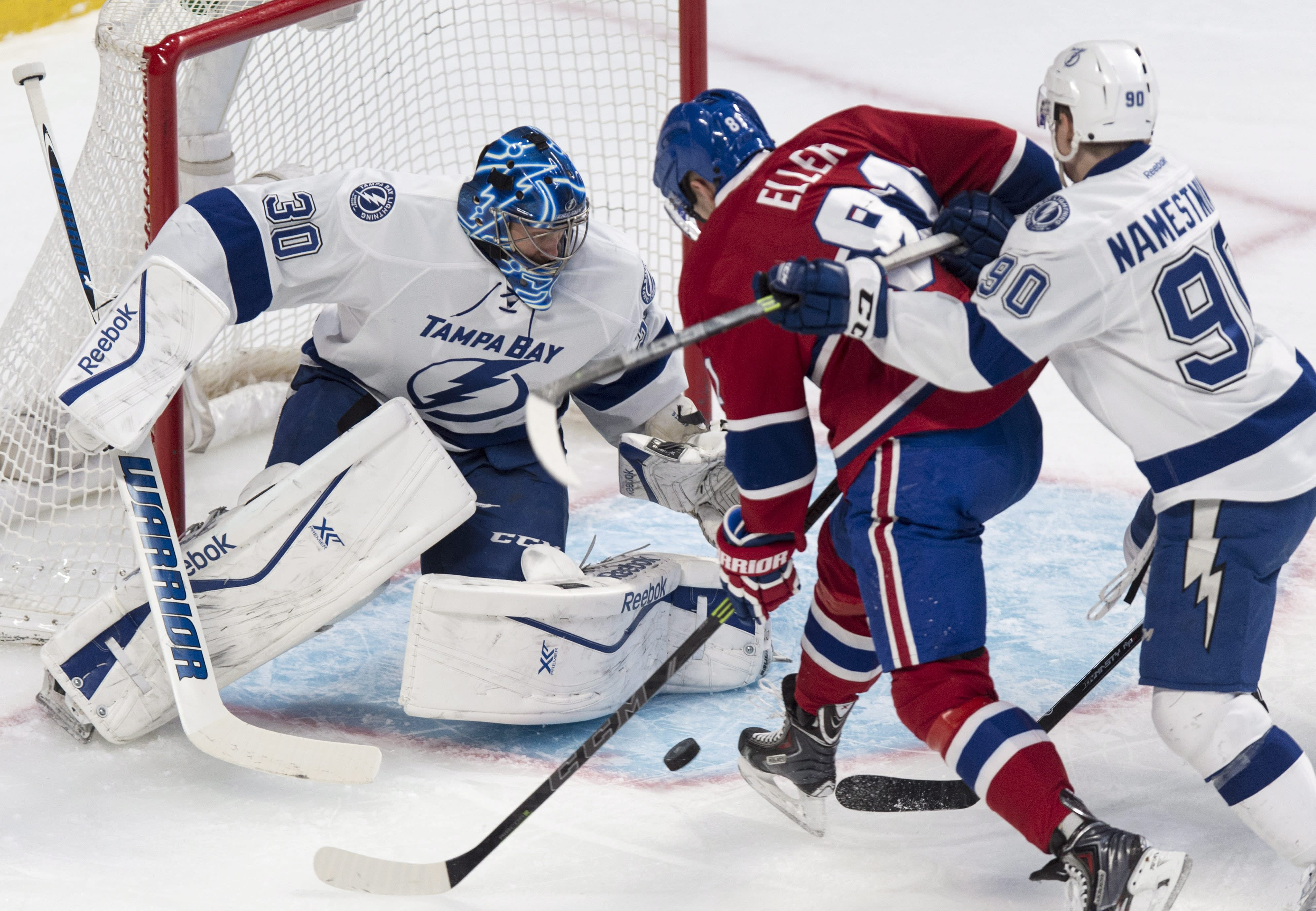Lightning clinch playoff berth with 5-3 win at Montreal