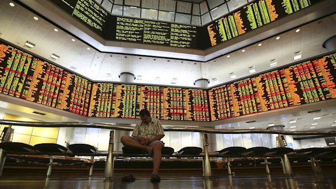 A man rests inside a stock exchange in Kuala Lumpur