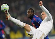 Pepe (L) of Real Madrid fights for the ball against Seydou Doumbia of CSKA Moscow during their round of 16, first leg UEFA Champions League match in Moscow. The game ended 1-1