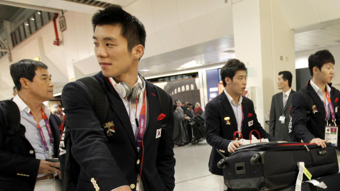 Members of the South Korean men gymnastics team arrives at Heathrow Airport in London, Monday, July 16, 2012.  Competitors are arriving in London during preparations for the upcoming London 2012 Olympic Games.  (AP Photo/Charlie Riedel)