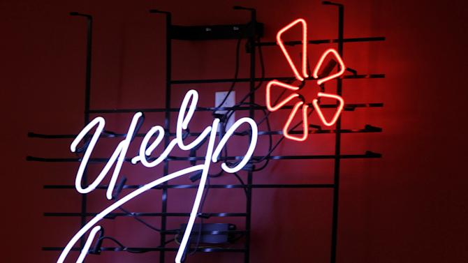 Yelp shares surge 64 percent in stock market debut