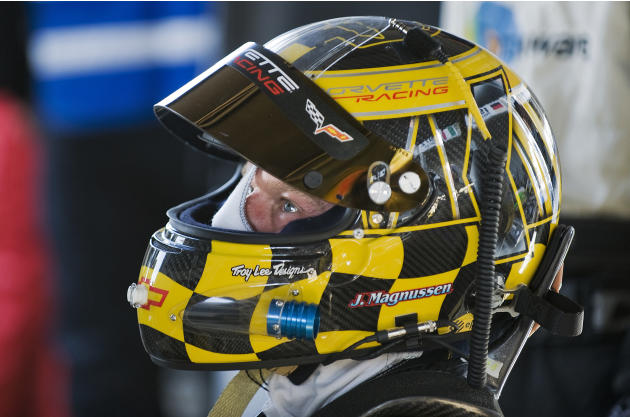 Corvette Racing's Jan Magnussen, of Denmark, watches the race on television while he waits in pit row for his turn to drive during the 59th annual American Le Mans Series 12 Hours of Sebring auto race