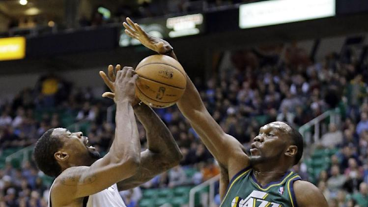 Utah Jazz center Al Jefferson (25) blocks the shot of Los Angeles Clippers center DeAndre Jordan, left, in the first quarter during an NBA basketball game on Friday, Dec. 28, 2012, in Salt Lake City. (AP Photo/Rick Bowmer)