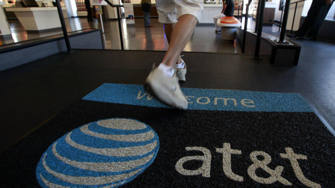 AT&T revenue up, profit down as costs rise in 2Q
