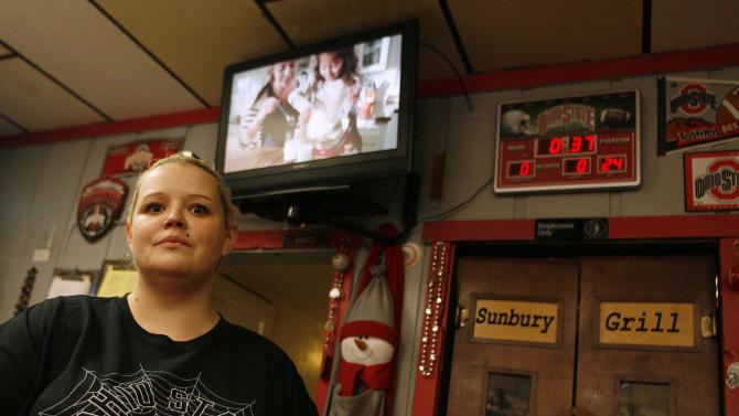 This photo taken Oct. 26, 2012 shows Sarah Arrowsmith, owner of the Sunbury Grill in Sunbury, Ohio, There's a television screen blinking in the back of the eatery. But these days, owner Arrowsmith keeps it on mute. The relentless onslaught of political ads, she says, are driving her customers _ most of them older, drawn by both the homey atmosphere and the 10 percent senior discount _ crazy. (AP Photo/Mike Munden)