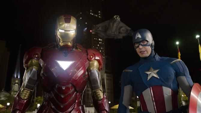 """FILE - This file photo of a film image released by Disney shows Iron Man, portrayed by Robert Downey Jr., left, and Captain America, portrayed by Chris Evans, in a scene from """"The Avengers.""""  Disney/Marvel's """"The Avengers"""" should top domestic box office for a third straight weekend, fending off wide-release newcomers with another $50 million in receipts. (AP Photo/Disney, File)"""