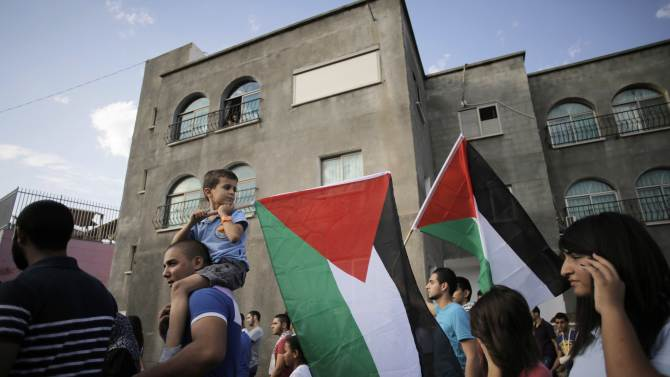 An Israeli Arab boy carries a Palestinian flag during a march in Sakhnin