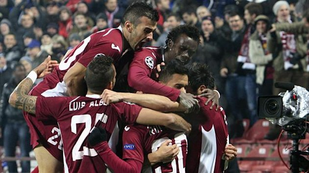 CFR Cluj's players celebrate after Rui Pedro scored against Braga (Reuters)