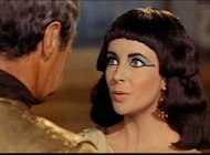 """Screenshot of Rex Harrison and Elizabeth Taylor from the trailer for the film Cleopatra"" (Cropped)."